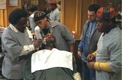 Michael Ealy (Ricky), Troy Garity (Isaac), and Leonard Howze (Dinka) look on (center left to right) while Cedric The Entertainer (Eddie, far left) gives a shave