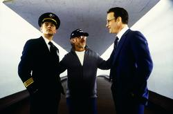 Director STEVEN SPIELBERG (center) goes over a scene with stars LEONARDO DICAPRIO (left) and TOM HANKS while filming at the famed TWA Terminal at New York's JFK Airport, one of the locations used for DreamWorks Pictures' CATCH ME IF YOU CAN.